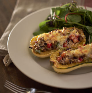 Delicata Squash Stuffed with Sausage Peppers and Onions